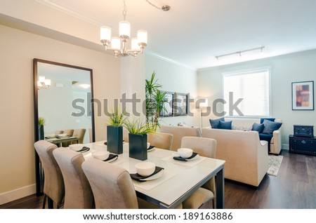 Modern bright dining room with a living room in a luxury apartment. Interior design. - stock photo