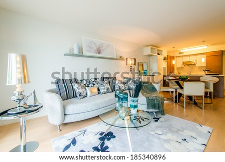 Modern bright living room with a dining room and kitchen in a luxury house. Interior design. - stock photo