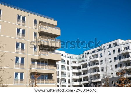 Modern brown and white apartment houses seen in Berlin - stock photo