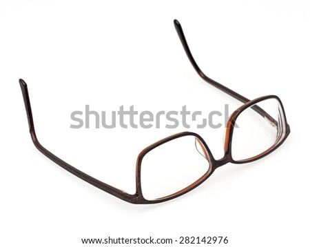 modern brown glasses on white background - stock photo