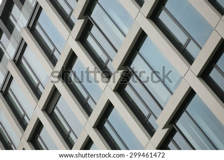 modern building detail background with sky color reflection - stock photo
