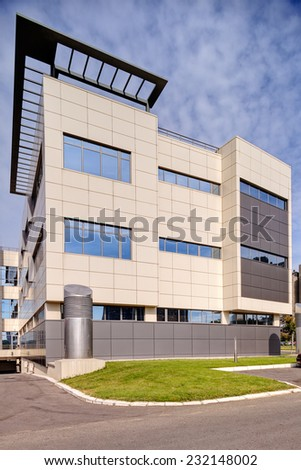 Modern building exterior with glass and metallic facade - stock photo