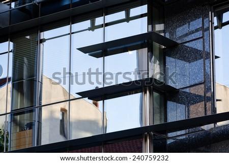 Modern building exterior with glass and metallic facade - stock photo
