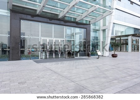Modern building facade with empty road in china urban city downtown district. - stock photo