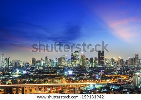 Modern building in Bangkok city at twilight,Thailand  - stock photo