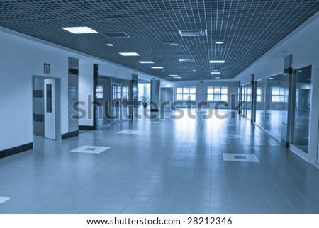 Modern building interior in blue tones - stock photo