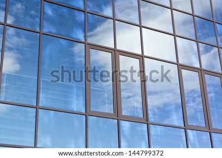 Modern building mirror glass wall background - stock photo