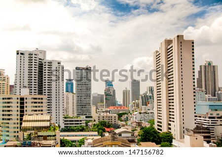 Modern building on blue sky background - stock photo