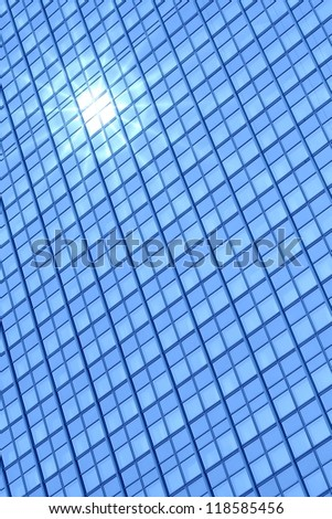 Modern building windows and sun reflection - stock photo