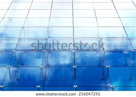 modern building with blue glass paneling - stock photo