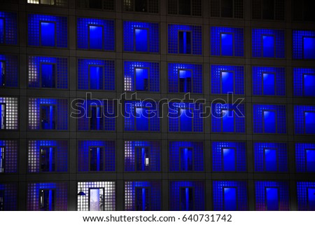 Modern building with blue lit windows