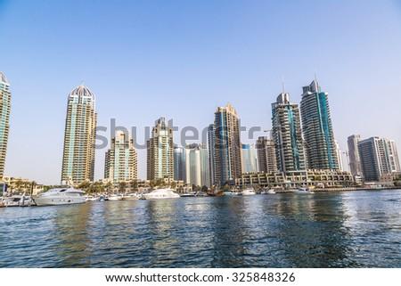 Modern buildings in Dubai Marina, Dubai, UAE in a summer day - stock photo