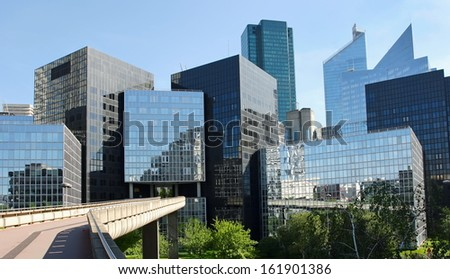 Modern buildings in the business district of La Defense to the west of Paris, France. - stock photo