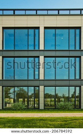 Modern business building during sunset. - stock photo