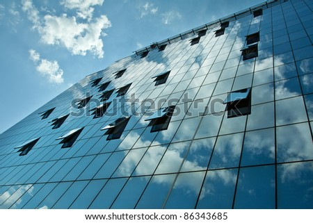 Modern business building with sky reflection - stock photo