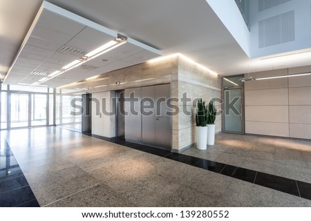Modern business centre, corridor and elevators - stock photo