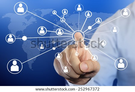 Modern business concept image of a Businessman clicking people connection icon on blue background - stock photo