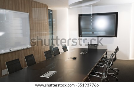 Modern business meeting room with armchairs and desk