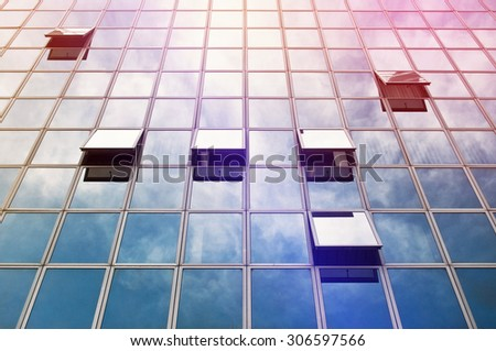 Modern Business Office Building Exterior, Facade with Glass Windows Open and Closed, Sunlight Reflecting - stock photo