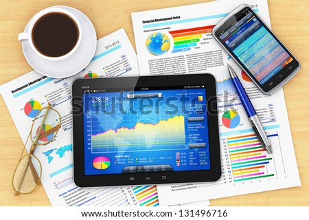 Modern business office workplace: tablet PC computer, smartphone with stock market application, documents with financial reports, graphs and charts, pen, eyeglasses and cup of coffee on office table - stock photo