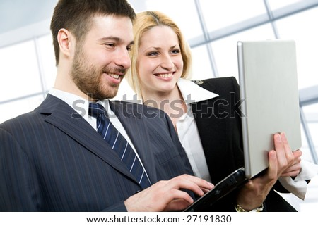 Modern business people doing some computer work together - stock photo