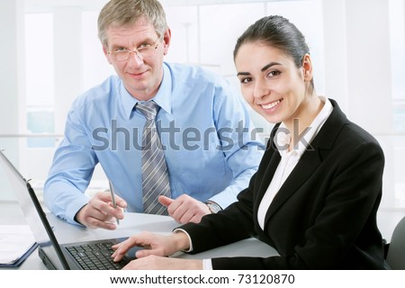 Modern business people look at the camera - stock photo