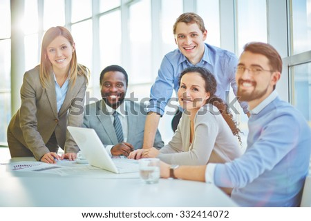 Modern business people sitting at workplace - stock photo