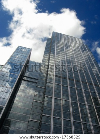 Modern business skyscraper in Canary Wharf, London - stock photo