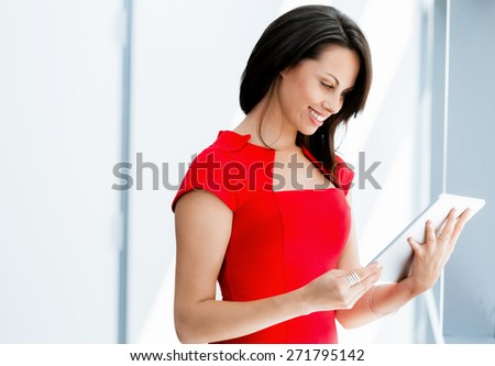 Modern business woman in the office with tablet - stock photo