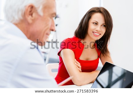 Modern business woman sitting in the office - stock photo