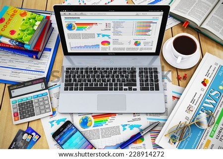 Modern business work, internet communication and financial development, growth and success technology concept: laptop, smartphone, newspaper, calculator, credit cards, pen, books and coffee on table - stock photo