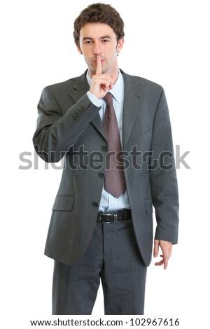 Modern businessman showing shh gesture - stock photo