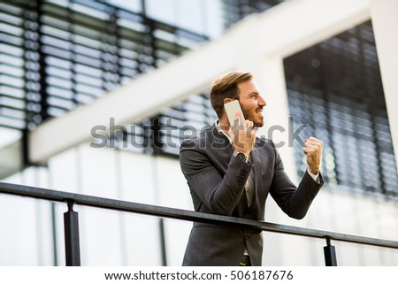 Modern businessman talking over the phone in the office