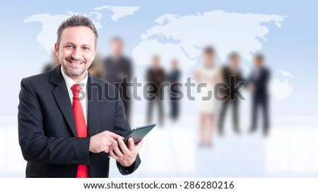 Modern businessman using tablet with business people background