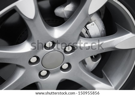 Modern car alloy wheel - stock photo