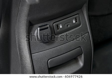 Modern car console with USB plugs for rear passengers