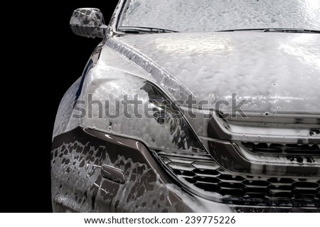 Modern car covered by foam. Car wash. - stock photo