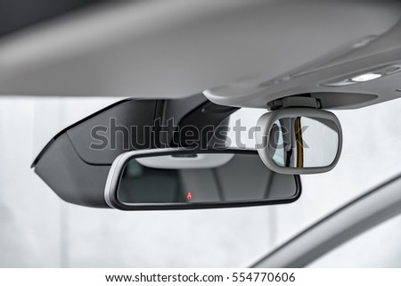 Modern car driver and child rear-view mirror