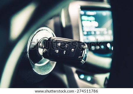 Modern Car Ignition Keys with Remote Alarm and Central Lock System. Driving Theme. - stock photo