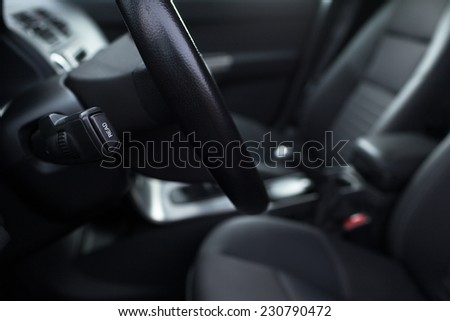 Modern car interior (color toned image; shallow DOF) - stock photo