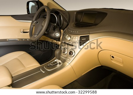 Modern Car Interior in Beige Leather - stock photo
