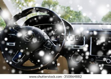 Modern car interior. Steering wheel over snow effect - stock photo