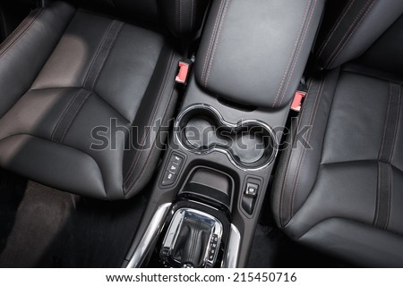 Modern Car Interior Top View. Black Leather Brand New Car Interior. - stock photo