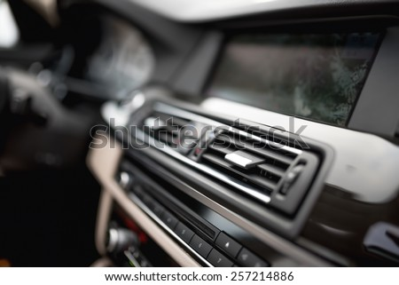 modern car interior with close-up of ventilation system holes and air conditioning. Concept wallpaper for auto air conditioning and dashboard - stock photo