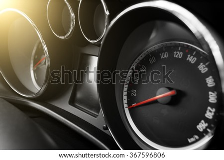 modern car speedometer and odometer at daytime - stock photo