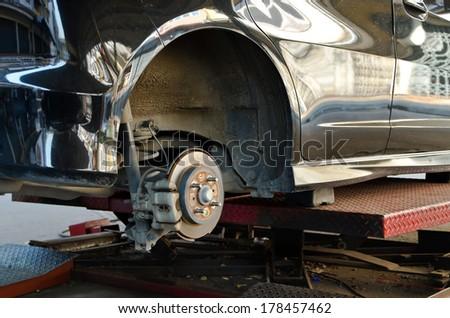 Modern Car take wheel off show disk brake assembly - stock photo