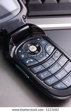 Modern cellphone on laptop
