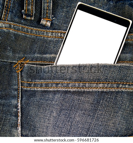 Modern cellphone with blank screen inside blue jeans pocket