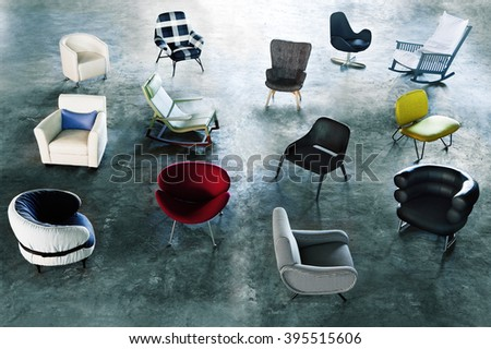 modern chairs and armchairs on a abstract background on a studio photo - stock photo