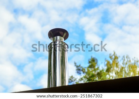 Modern chimney on the roof of house - stock photo